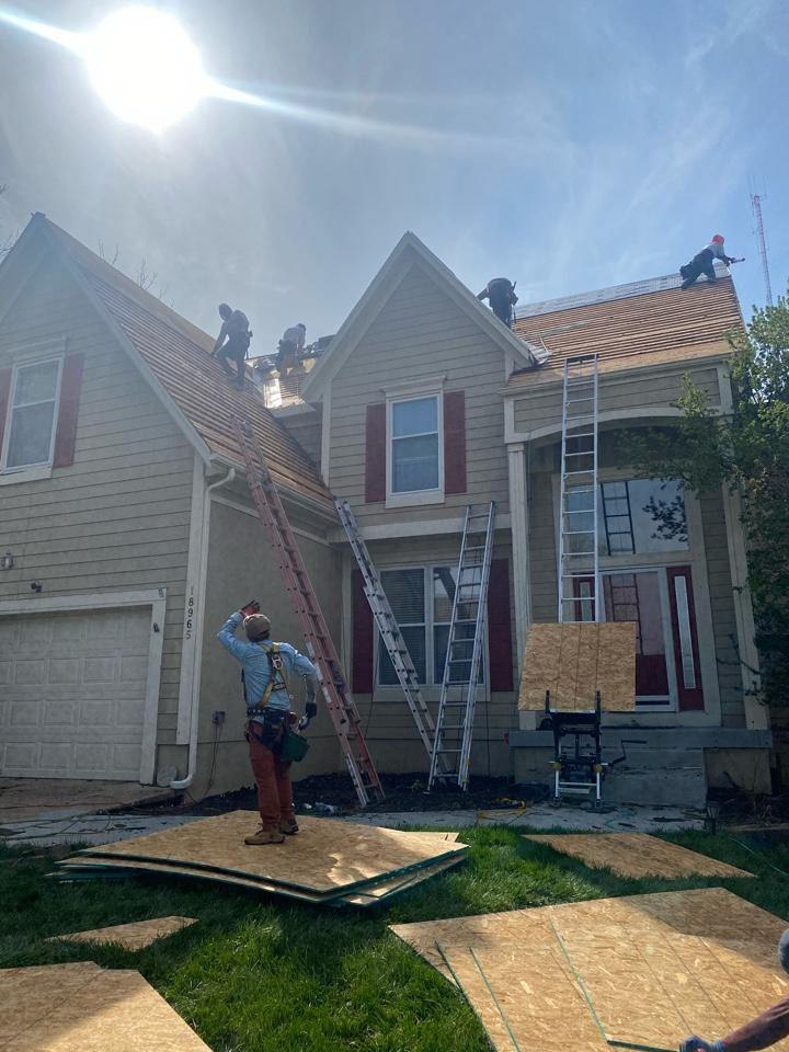 Olathe, KS - Wood shake is all removed and we are wrapping up on installing the new OSB.  We will have this roof completely done by this evening and the homeowner is always sure to be happy with the look of a GAF Timberline ULTRA shingle on a roof. I Can't wait for this family to see it when it's done.