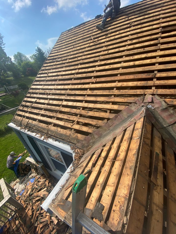 Independence, MO - Removing three layers of shingles and installing new OSB.  We will install a GAF roofing system color Pewter Grey with synthetic underlayment and a new ventilation system for the roof.