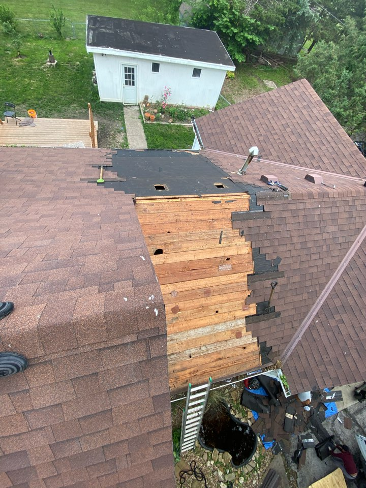 Gardner, KS - Fixing ugly hump on the roof buckling the shingles caused by a home addition not being built flush with existing house.. adding some plywood bringing it back to plain and it's sure to look perfect by the time we are done.