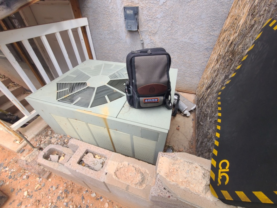 Santa Clara, UT - Ruud air conditioning system maintenance.
