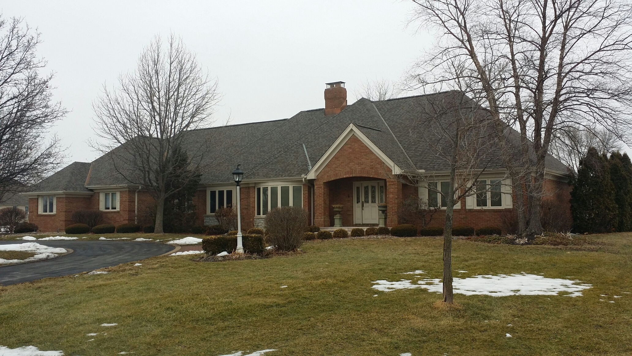 Highland, IN - Certainteed Landmark weatherdwood shingle with copper valleys and copper chimney flashing.