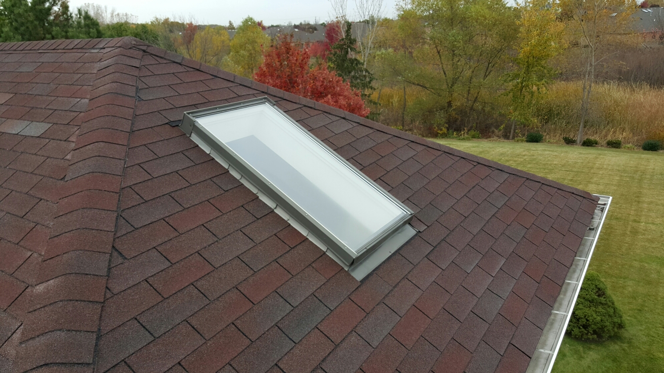 Frankfort, IL - Replacing an old leaky skylight with a new Velux solar powered vented skylight.