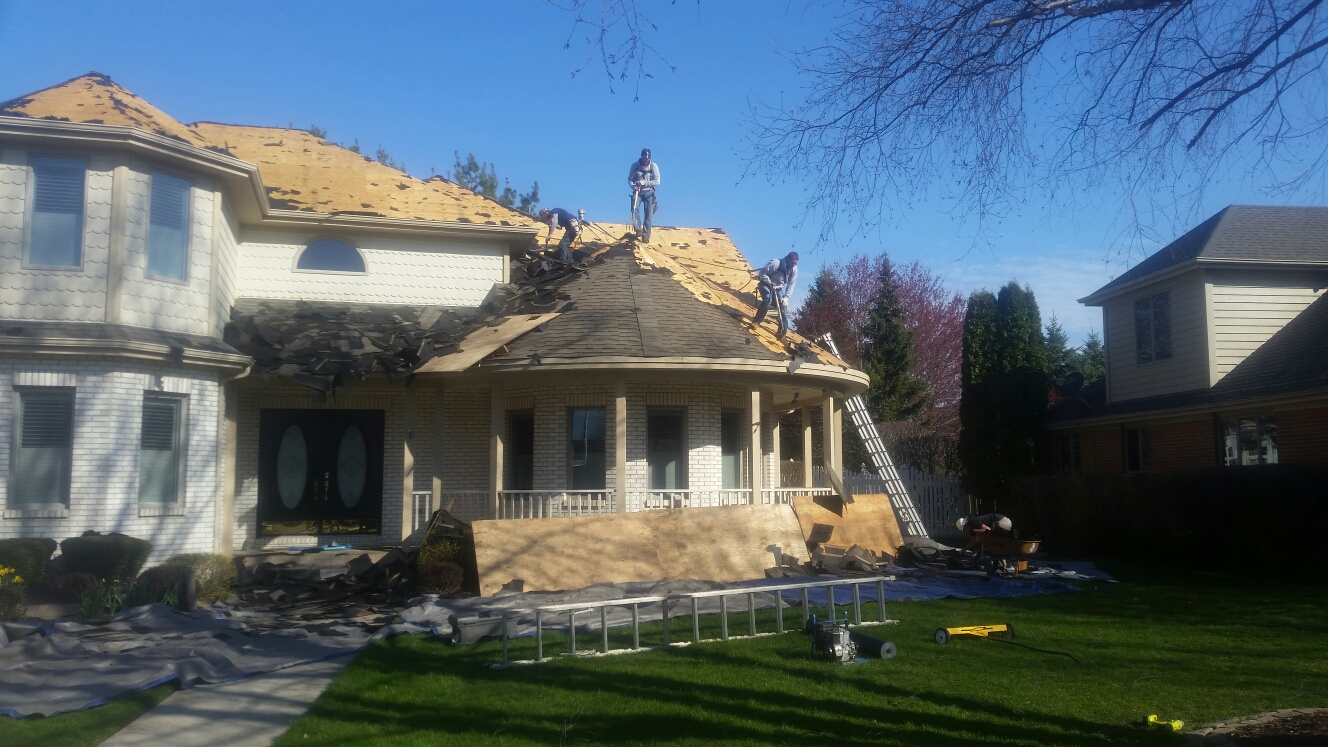 Munster, IN - Tearing off roofing material and preparing deck for ice and water.