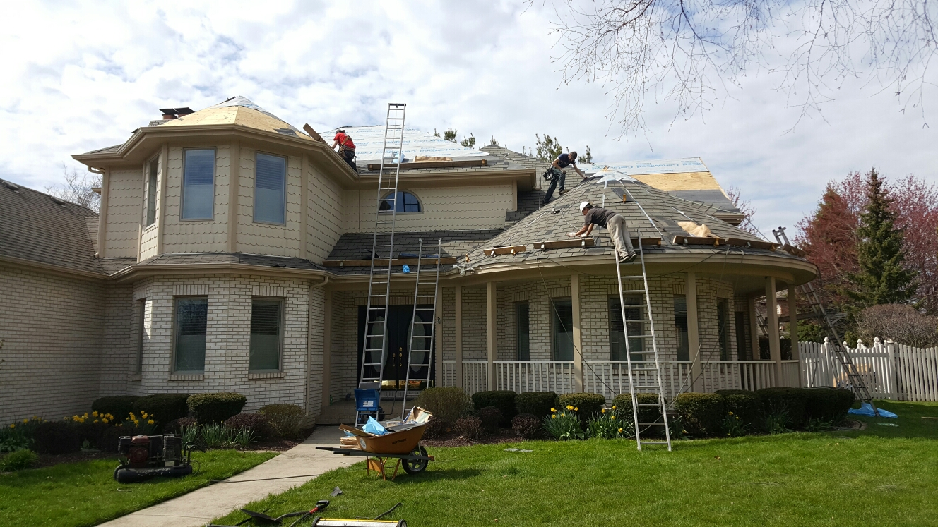 Munster, IN - Installing a new CertainTeed Hatteras shingle and new Velux skylights