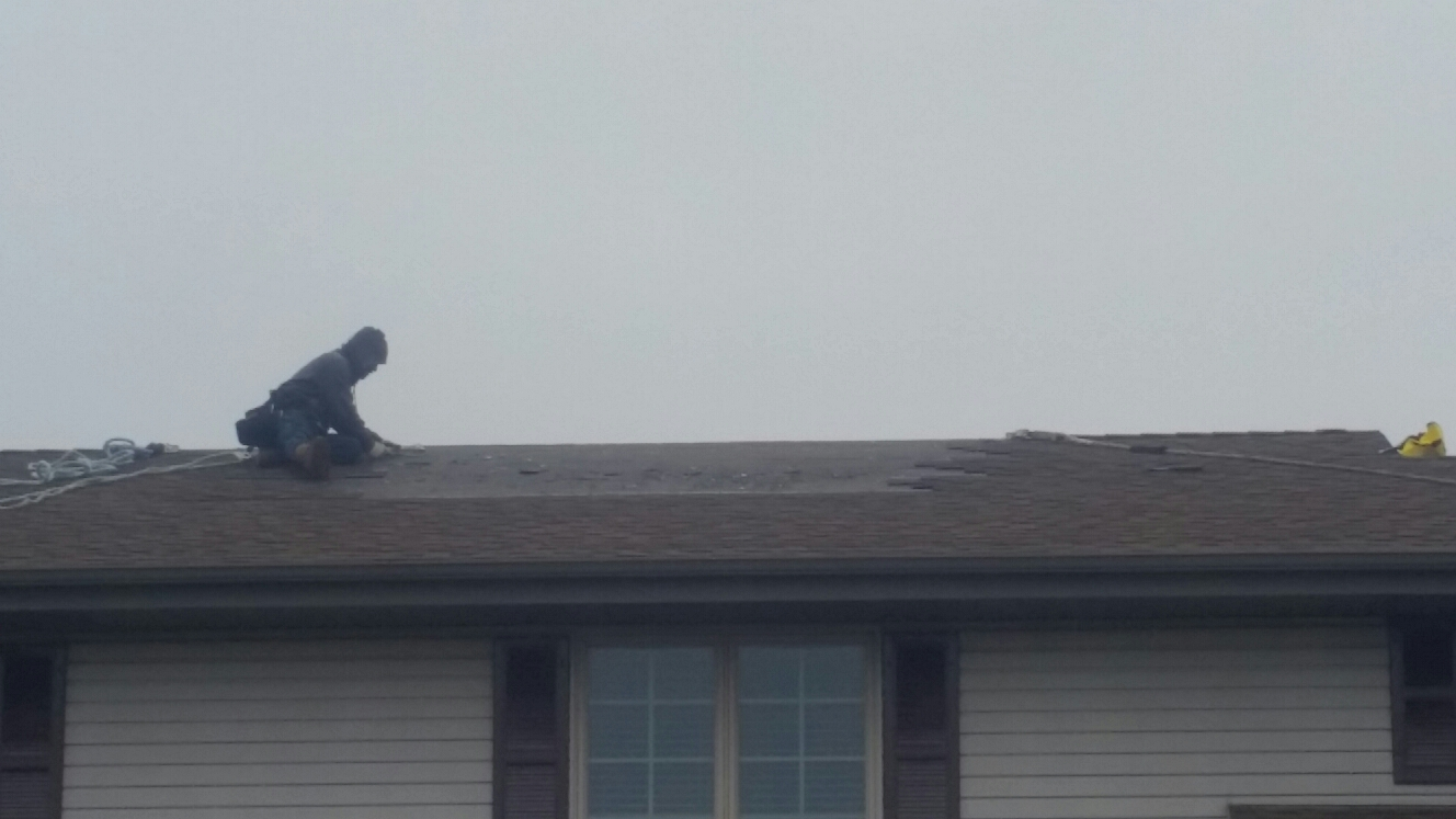 Schererville, IN - Preparing area of blown off shingles to be repaired with CertainTeed lifetime shingles.