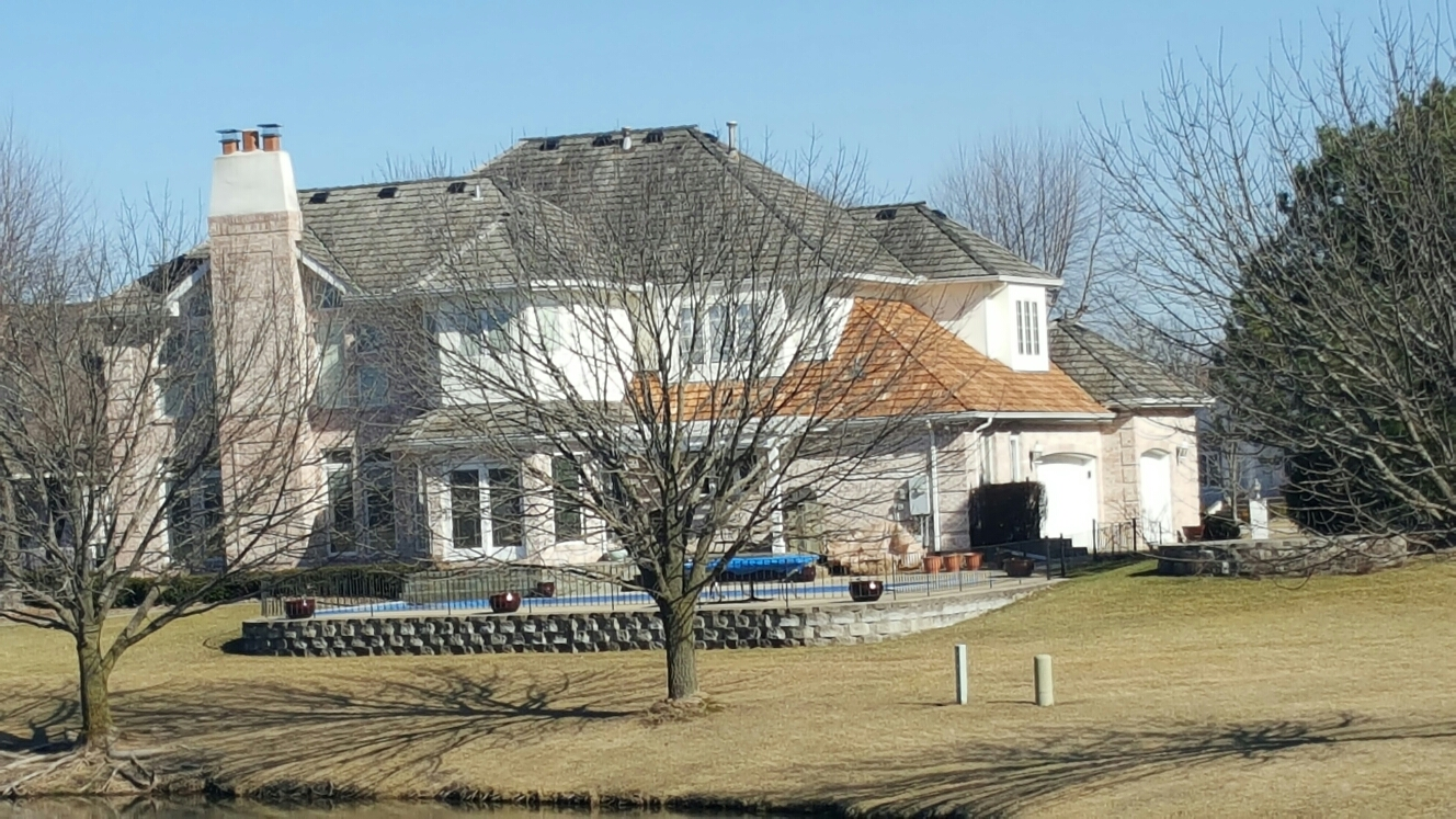 Dyer, IN - Replacing a section of cedar shake shingles.