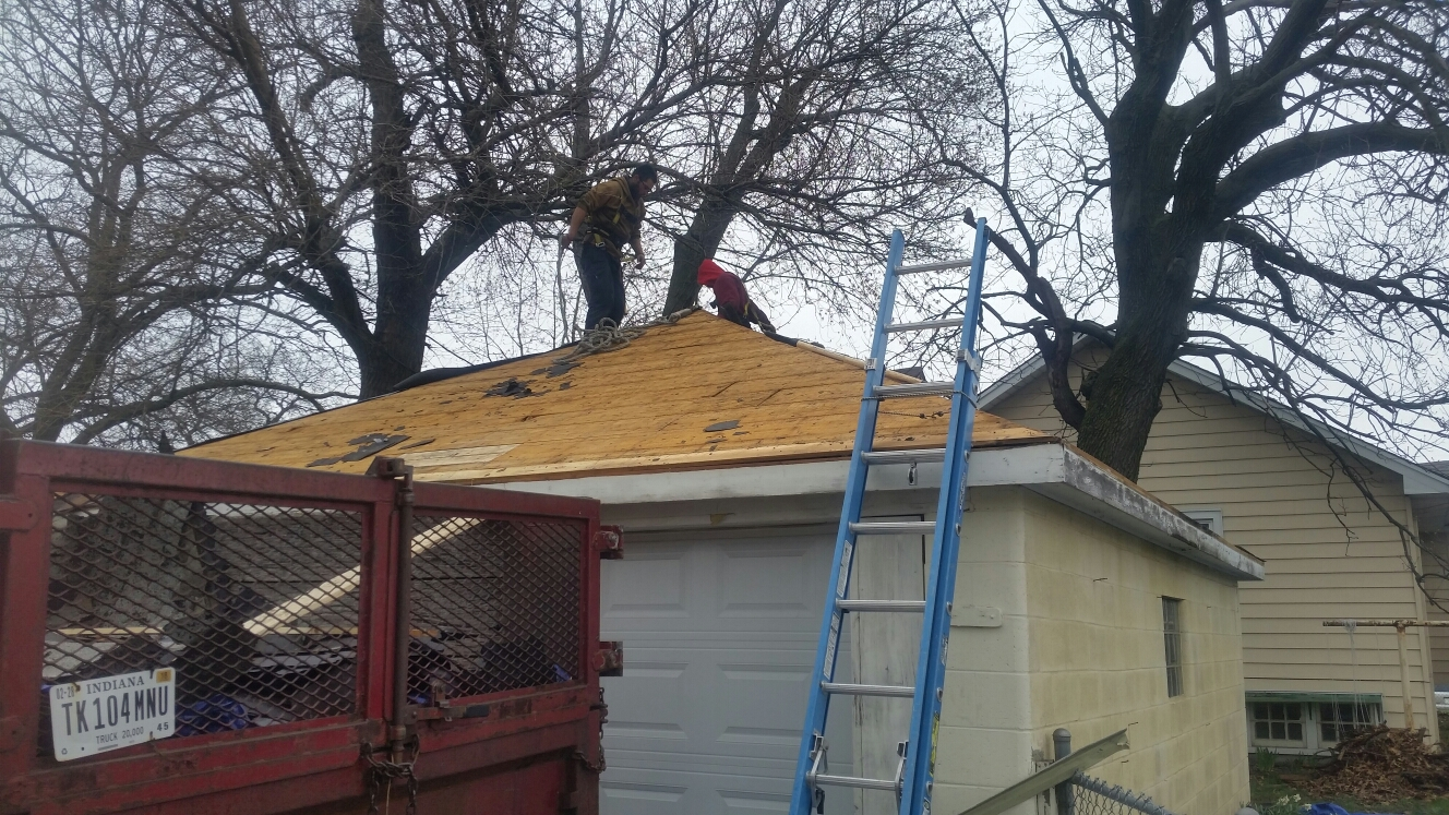 Hammond, IN - Preparing roof deck for installation of certainteed synthetic felt and certainteed lifetime shingles.