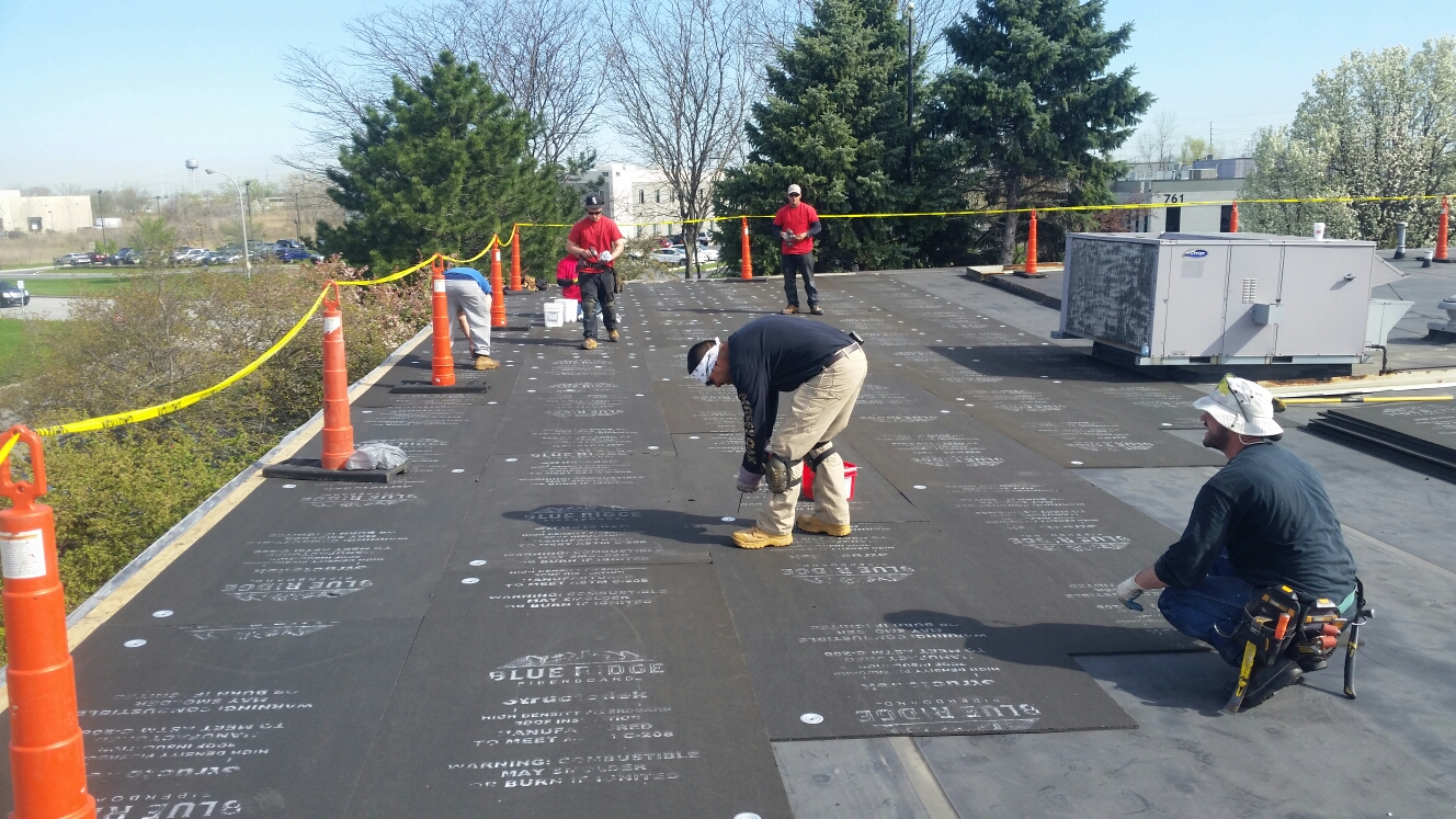 "Munster, IN - Installing 1/2"" fiberboard and preparing to accept fully adhered EPDM roofing system."