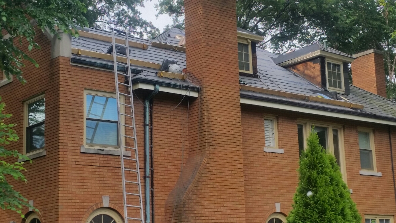 Hammond, IN - Installing CertainTeed Ice and Water with synthetic felt in preparation for installation of DaVinci tile shingles.