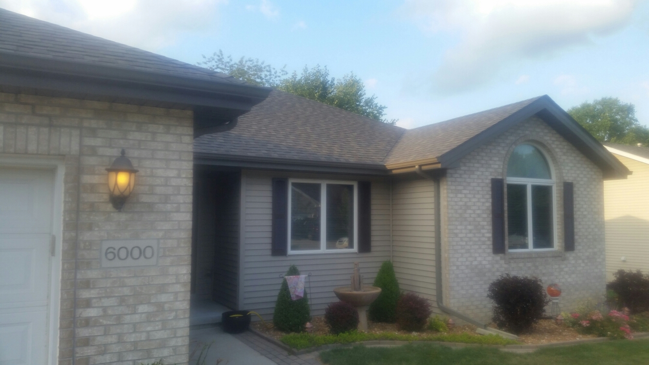 Schererville, IN - CertainTeed Landmark shingles (Driftwood), Quality Edge metal fascia, soffit and gutters (Terratone).