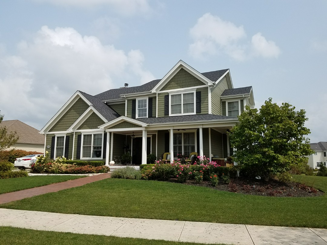 Frankfort, IL - Just completed a beautiful new Landmark Pro Series black shingle with new seamless aluminum gutters and downspouts