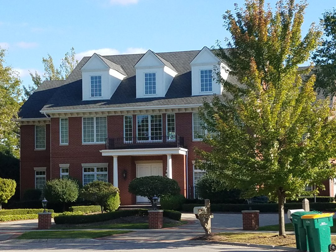 Munster, IN - New CertainTeed Grand Manor shingles with seamless aluminum gutters and downspouts