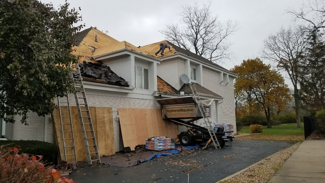 Dyer, IN - Installing a new CertainTeed Northgate premium shingle with new Velux skylights and seamless aluminum gutters and downspouts