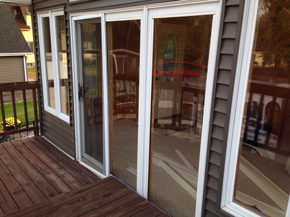 Virginia, MN - Removing existing patio door where glass has failed in residence in Mt. Iron, MN.