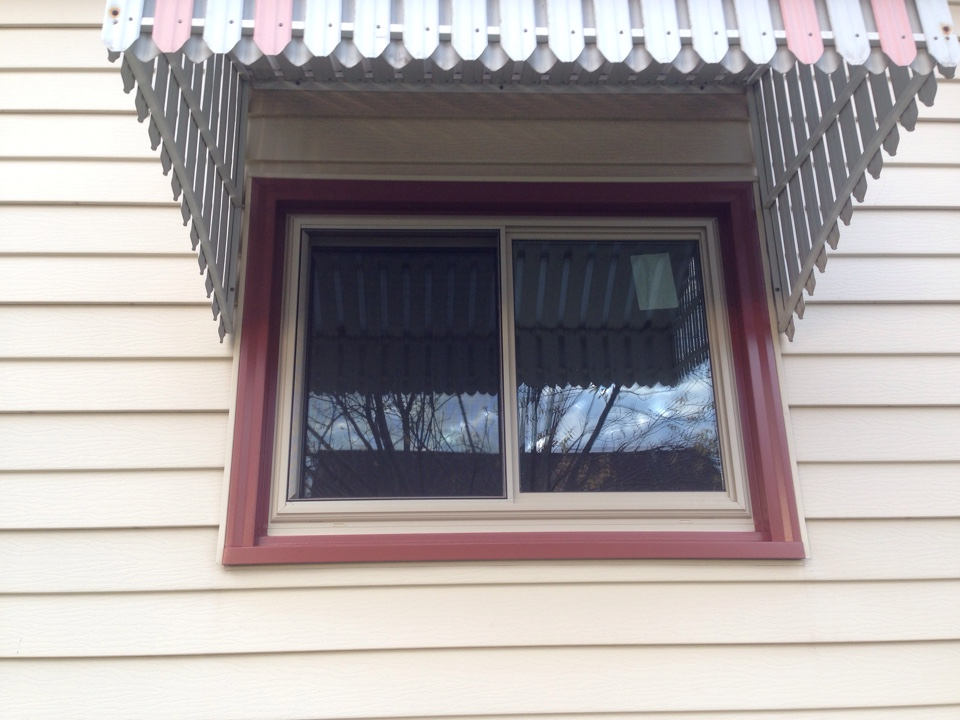 Gilbert, MN - New window with tan exterior and aluminum cladded trim for a maintenance free exterior.