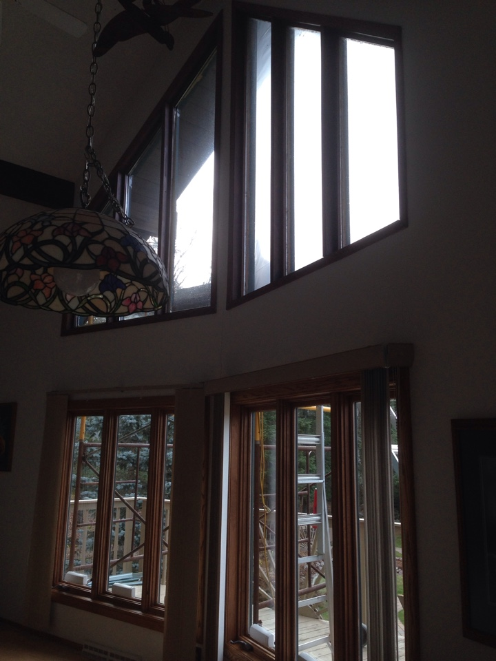 Virginia, MN - Interior view of existing upper trapezoid windows that are going to be replaced today in rural Virginia, MN.