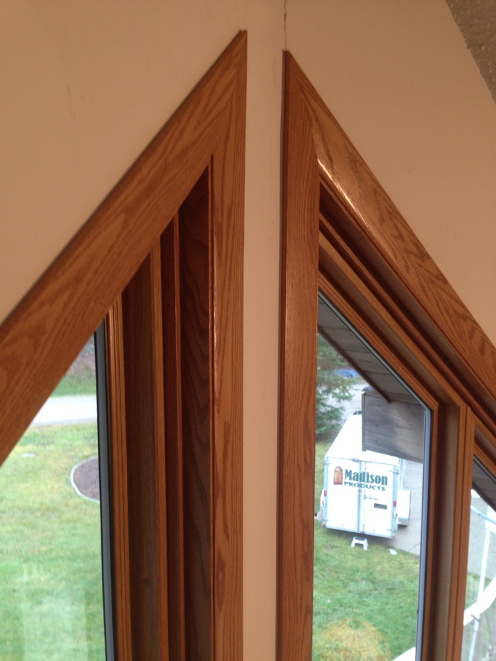 "Virginia, MN - New Restorations trapezoid windows with real oak Madera extension jambs and 3 1/4"" wide casing.  Challenging corner miters!"