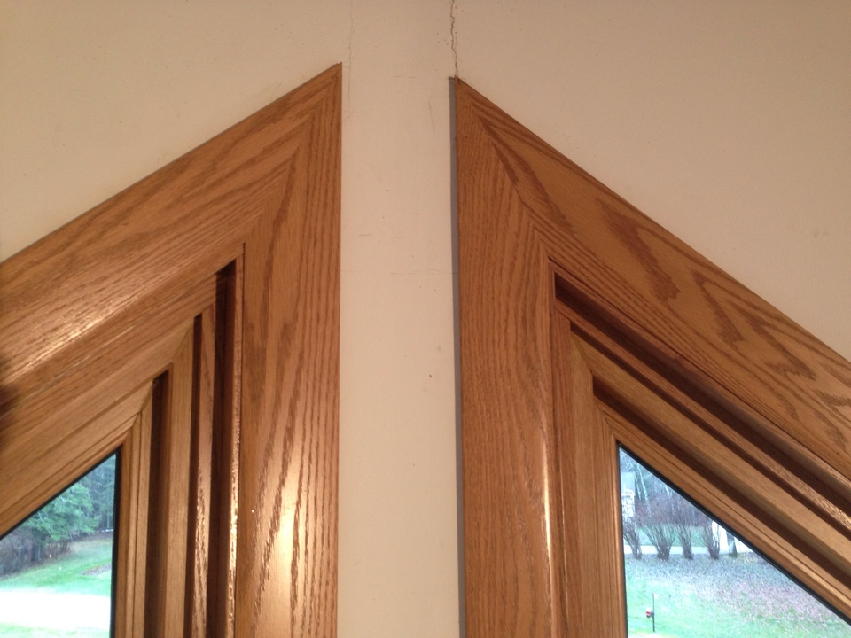 Virginia, MN - Free hand cut miters on trapezoid window tops.