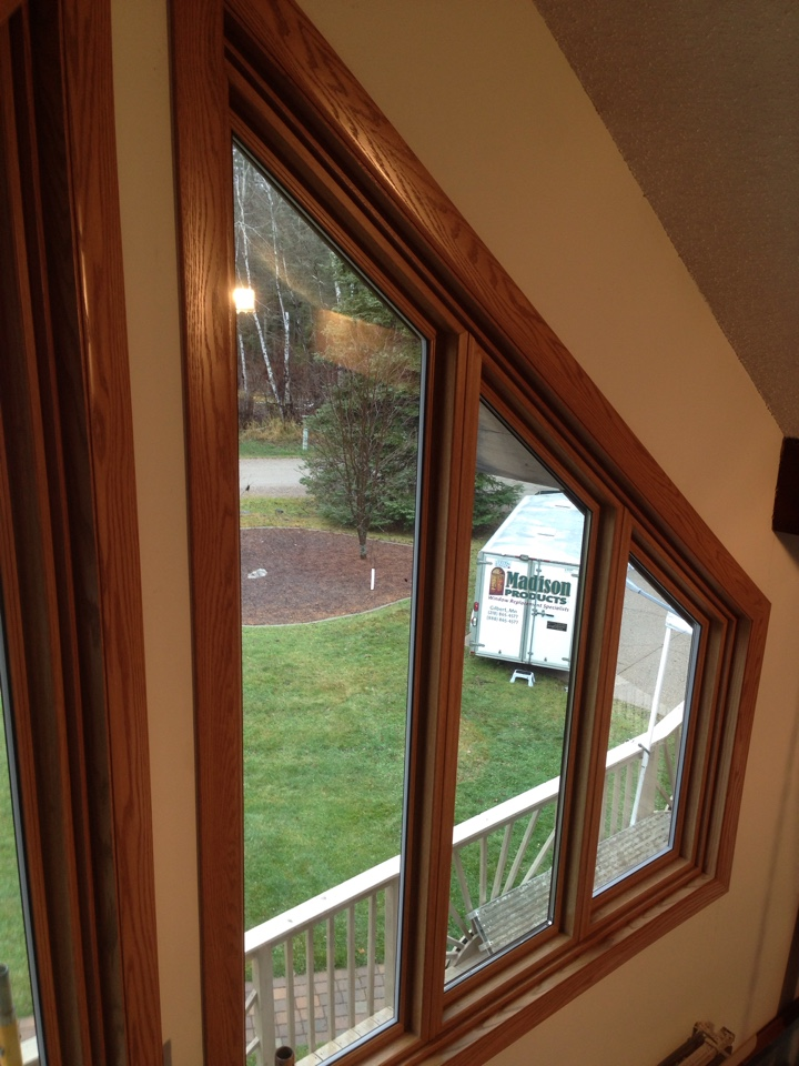 Virginia, MN - Just completed the installation of Restorations golden oak vinyl framed trapezoid windows with matching prefinished Madera oak trim and green aluminum cladded exterior trim.  Lifetime warranted windows should give this homeowner increased energy efficiency, no maintenance, and beauty for years to come.