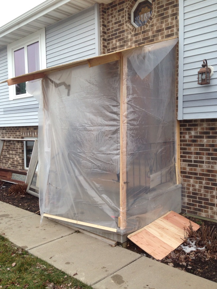 Eveleth, MN - Temporary shelter used while installing Wadena Millworks door in Gilbert, MN due to cold weather in November.