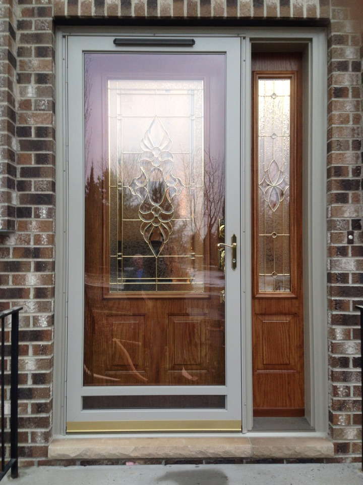 Gilbert, MN - New Wadena Millworks insulated prefinished woodgrained steel entrance door and sidelite plus sandstone aluminum storm door with bottom vent.  Customer says it's beautiful awesome.