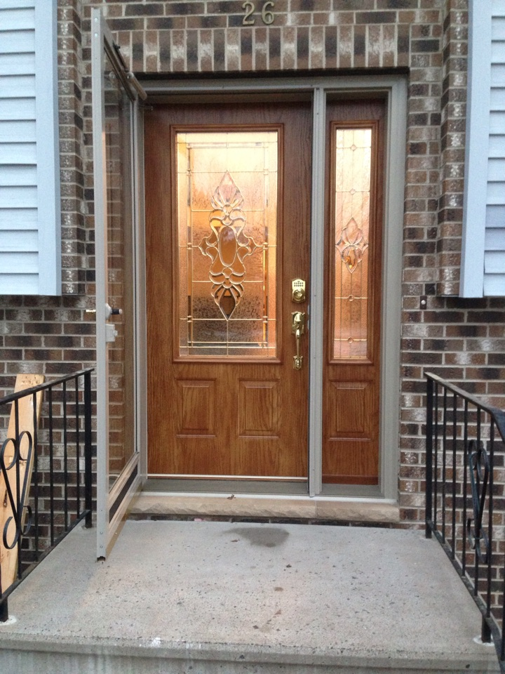 Gilbert, MN - New steel doors with cognac stain and sandstone trim, bright brass electronic deadbolt lock and D handle with thumb latch.  Very elegant!