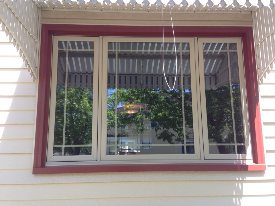 Gilbert, MN - New Restorations casement windows with perimeter grids between glass panes on home  in Gilbert ,MN.