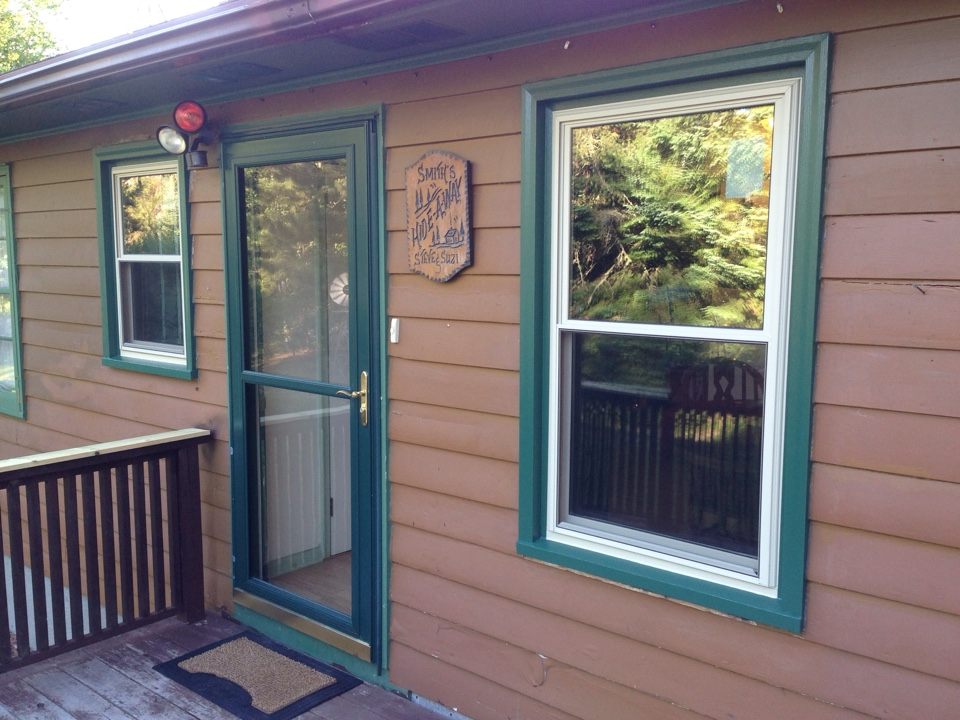 Virginia, MN - New Restorations windows with tan exteriors Golden Oak interiors with forest green trim really looks good on this home north of Virginia, MN.