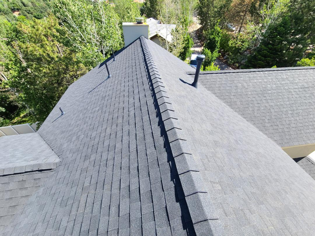 Sandy, UT - Full tear off of 2 layers of shingles and replace bad plywood as needed. 2 rows of ice and water shield with synthetic felt, Certainteed Landmark Morie Black shingles and high style hip and ridge with an upgrade to ridge venting for better attic ventilation