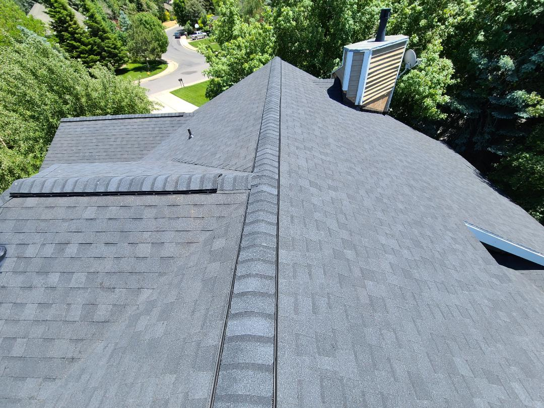 Bountiful, UT - Full tear off and remove siding to re-flash the walls correctly. 2 rows of ice and water shield, synthetic felt, cut in ridge venting, new Certainteed Landmark Morie Black shingles hip and ridge. Gave referrals for a siding and a gutter company.