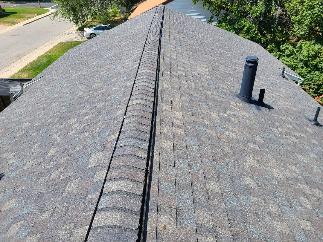 Washington Terrace, UT - Full tear off, 2 rows of ice and water shield with synthetic felt. New Certainteed Landmark Driftwood shingles and ridge with an upgrade to ridge venting.