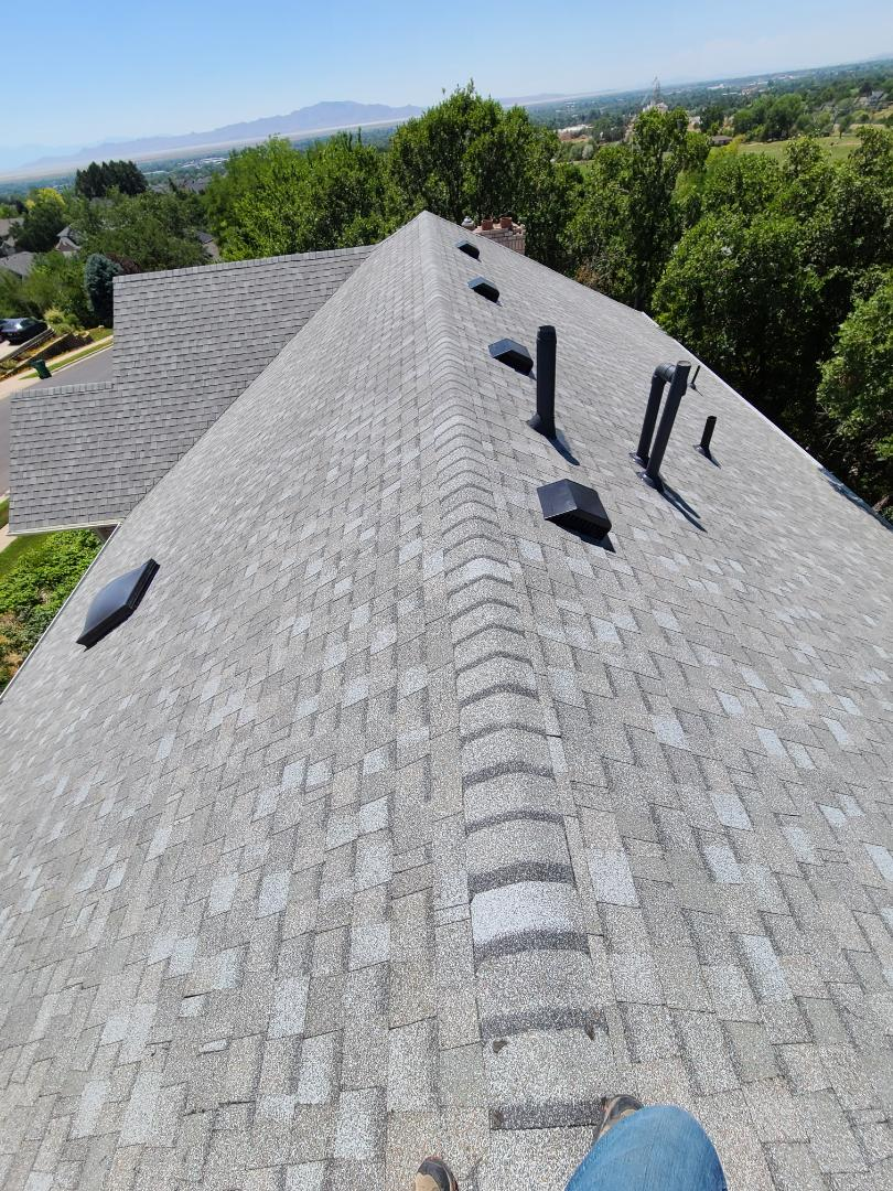 Layton, UT - Full cedar shake tear off. New underlayment, drip edge, architectural shingles, hip and ridge, 6 nailed for high winds. Gave a rain gutter referral.