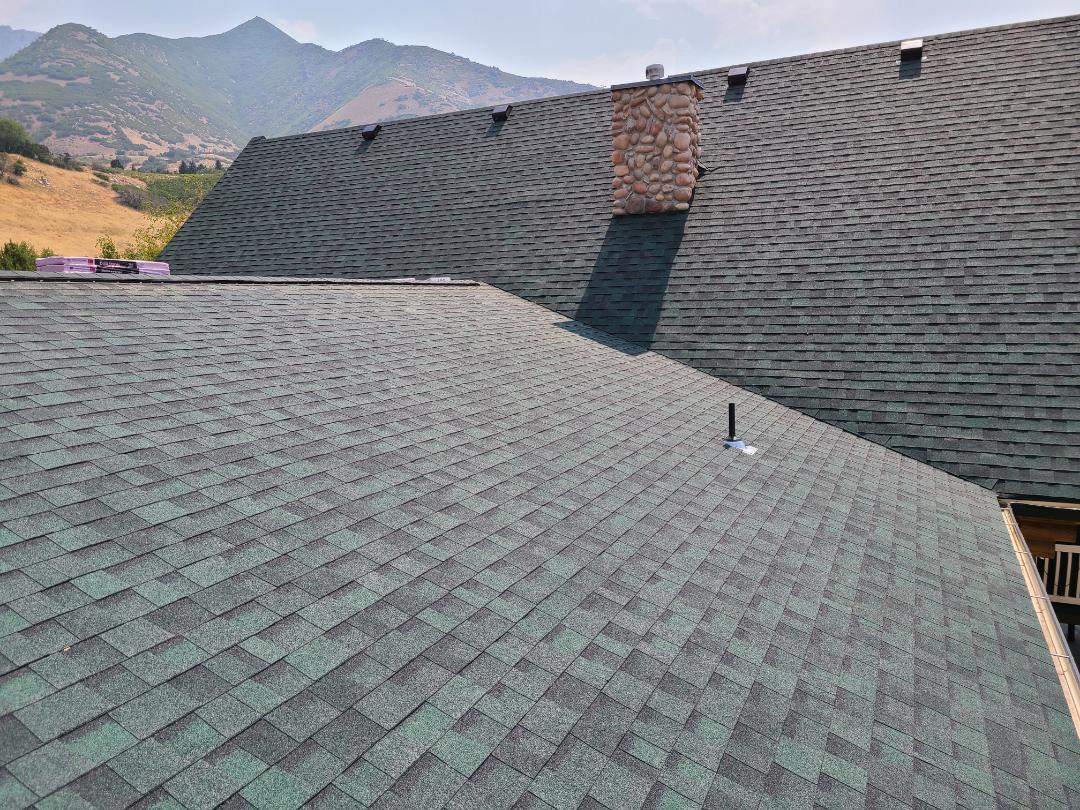 Uintah, UT - Full tear off, insurance claim, wind damage. 2 rows of ice and water shield, synthetic felt, Owen's Corning Duration shingles, hip and ridge, 6 nailed for high winds