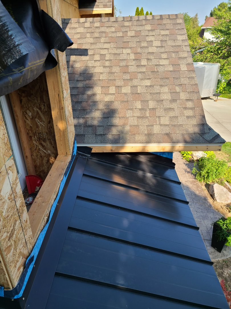 Kaysville, UT - Roof of a new addition with Certainteed Landmark shingles and ridge and 26 gauge standing seam metal.