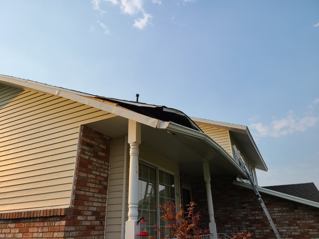 Layton, UT - Free estimate for roof repairs due to a tree hitting the roof. Referrals for siding, gutter and fencing damage.