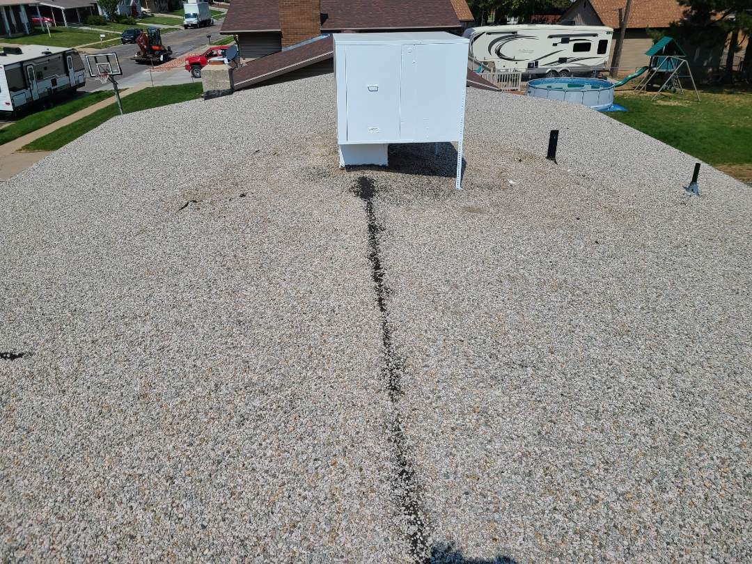 Riverdale, UT - Free estimate to tear off a tar and gravel roof and install TPO membrane on a single family residence