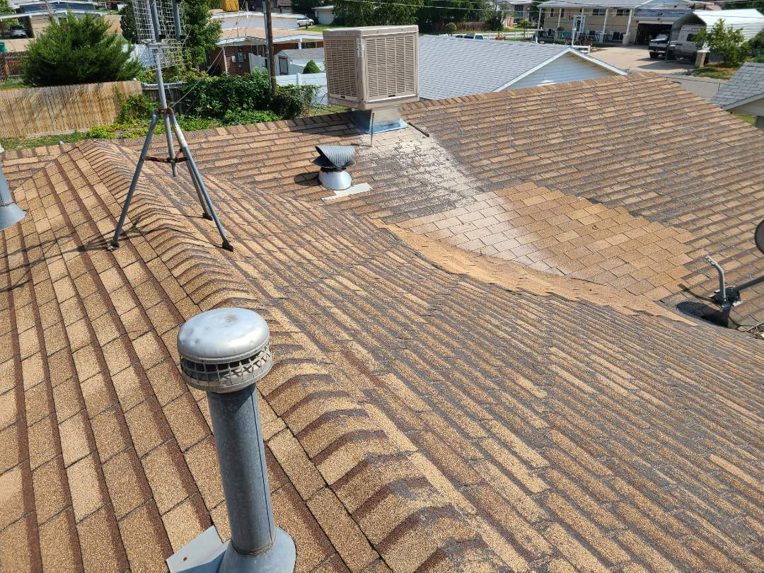 Layton, UT - Free estimate to replace a roof on an insurance claim for a property management company.