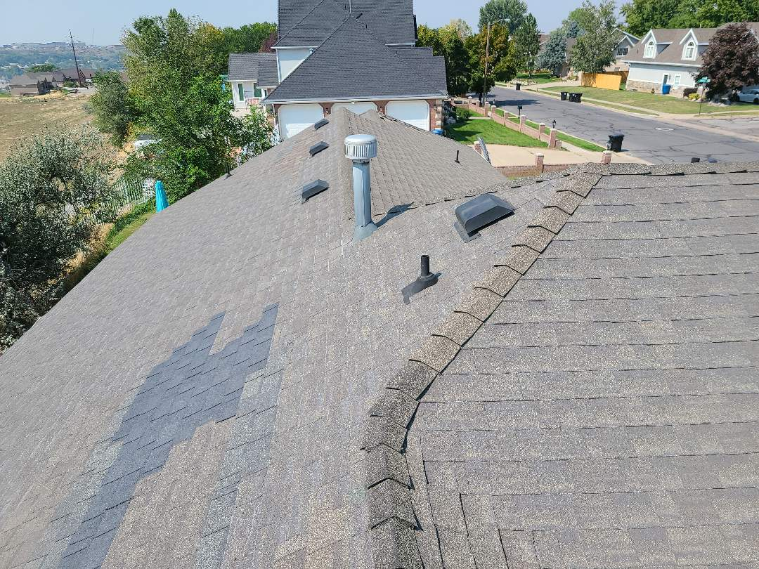 Washington Terrace, UT - Free estimate with options for wind repairs and a full roof replacement for a property management company