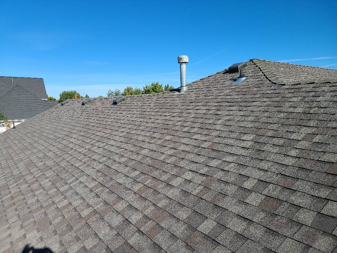 Ogden, UT - Recover of existing roof with new lifetime Certainteed Landmark Weathered Wood shingles and high style ridge.