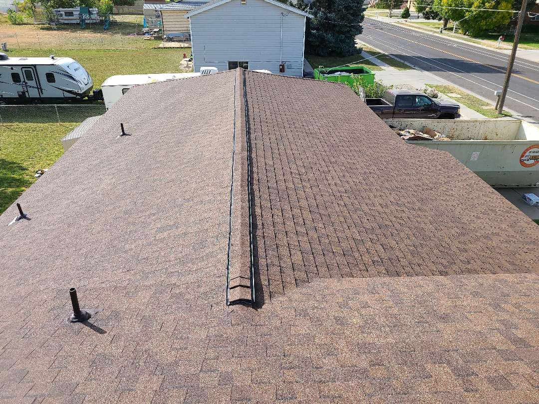 Syracuse, UT - 2 layer tear off. New architectural shingles, high style ridge and ridge vent.