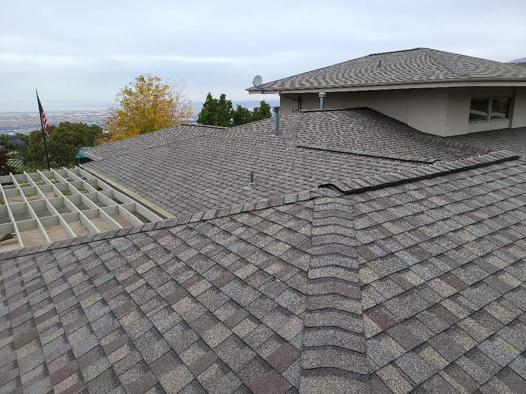 North Salt Lake, UT - Full tear off with new Certainteed Landmark Pro shingles, hip and ridge, ridge vent and new skylights.