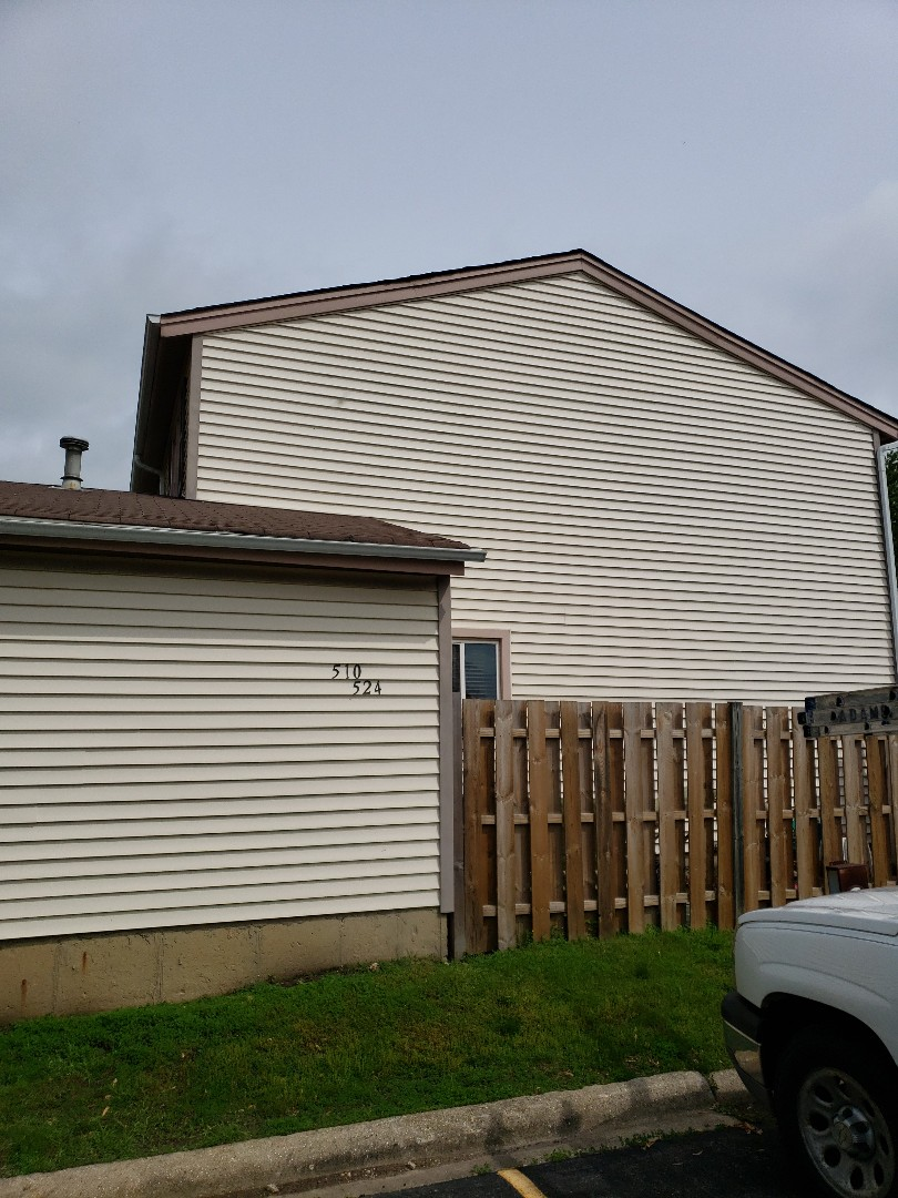 Bolingbrook, IL - Inspecting townhome associations roofs. Siding, gutters from recent hail storm