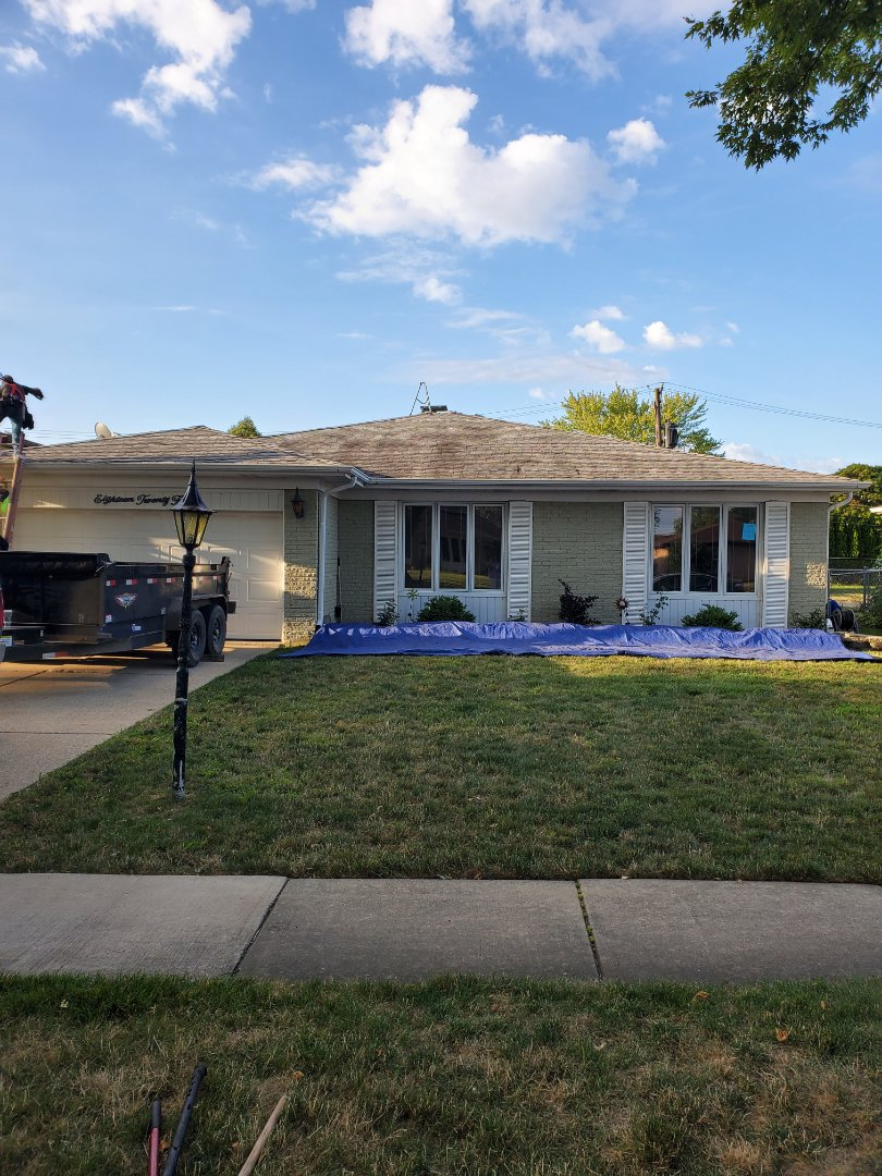 Mount Prospect, IL - Installing a new Owns Corning Oakridge roof system.
