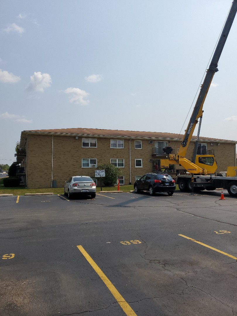 Addison, IL - New Owens Corning Oakridge Brownwood is going to be installed.