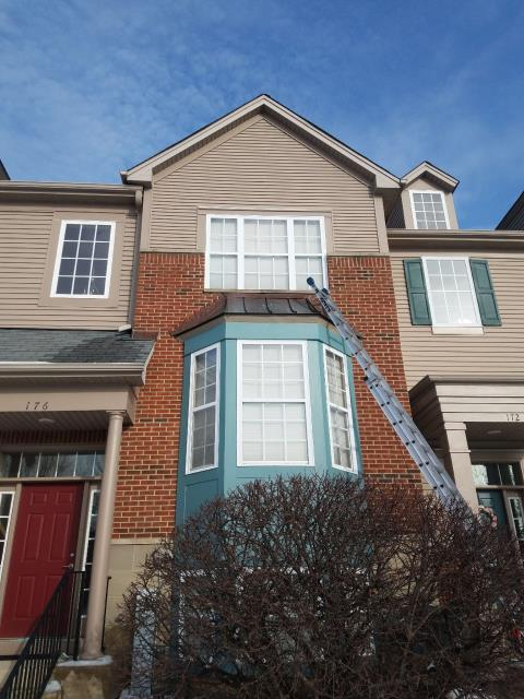 Grayslake, IL - Adams Service department removed and resealed the caulk above the bay window.