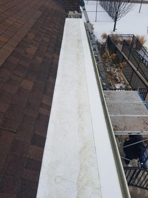 Aurora, IL - Our professional team installed a new GAF TPO roofing material and new shingles along the entire gutter edge.