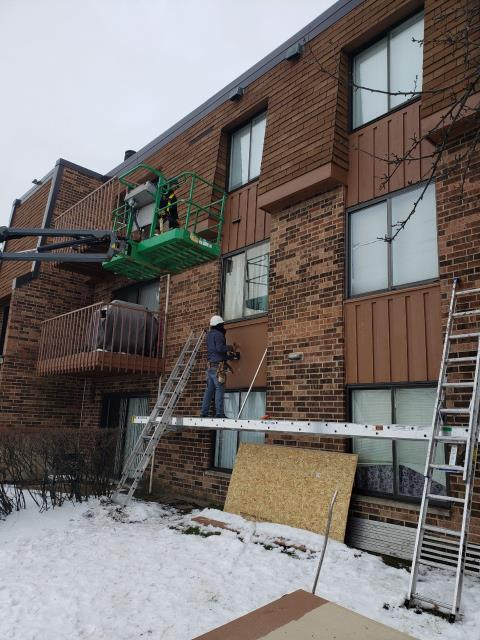 Schaumburg, IL - Our carpenters continued replacing all the wood siding on the entire front of the building.