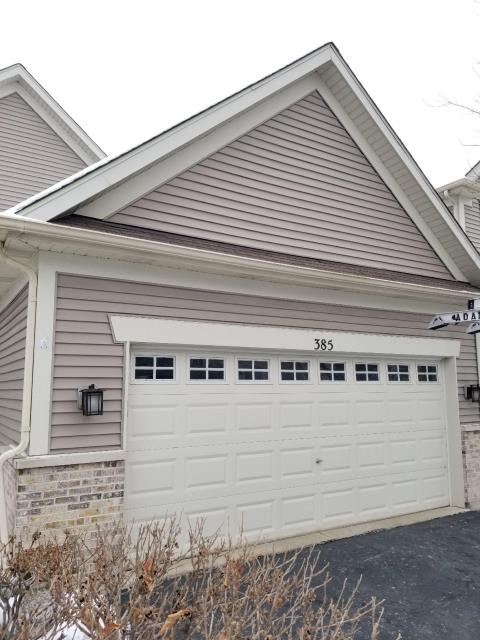 South Elgin, IL - During our siding inspection, we noticed the caulk along the flashing needed to be re-sealed.  We removed the old caulk and installed new all along the roof to wall flashing.