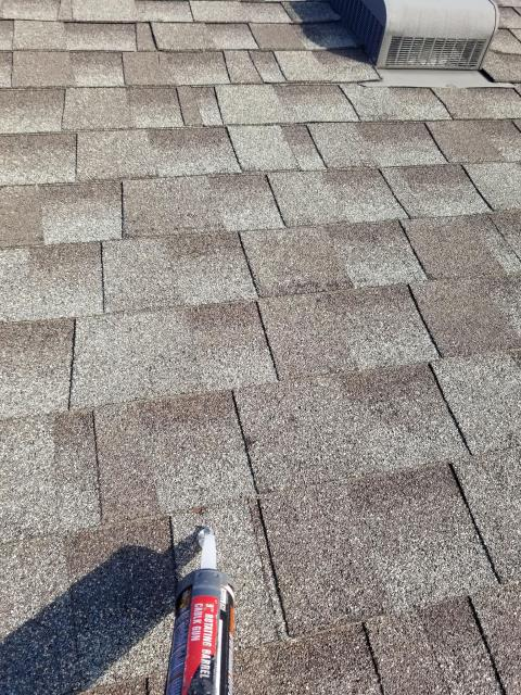 Darien, IL - During the roof inspection we noticed a low nail on a shingle that was causing a leak into the home, our installer removed the shingle and installed a new one.
