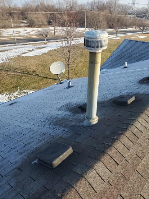 Joliet, IL - We were called for a roof leak and during our inspection we found water entering into the home from around the furnace pipe.